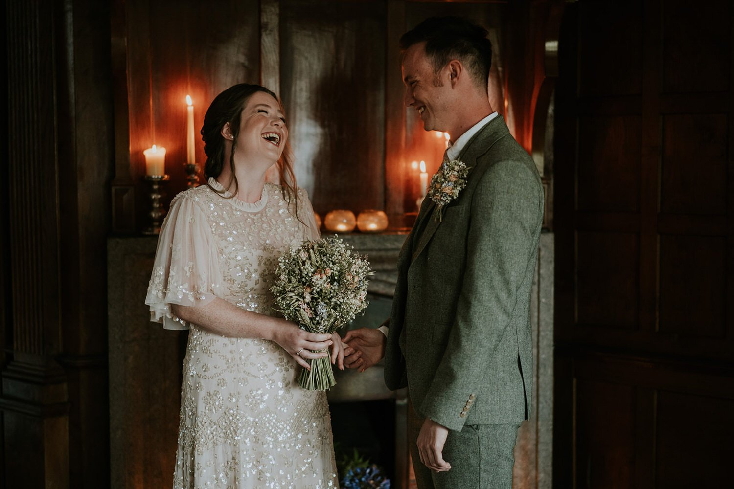 bride and groom on their Boho Cornwall Elopements laugh during their intimate romantic ceremony