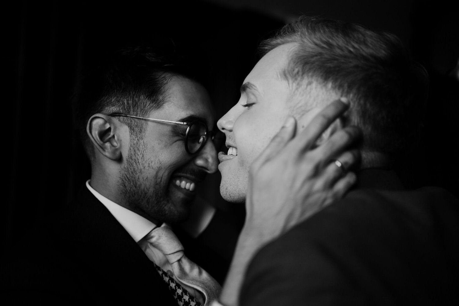 Same sex weddings at BoHo Cornwall elopements as two groom kiss each other on the nose