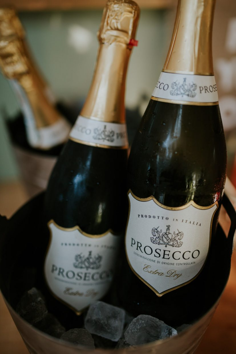 A close up image of bottles of champagne during a wedding breakfast on an elopement