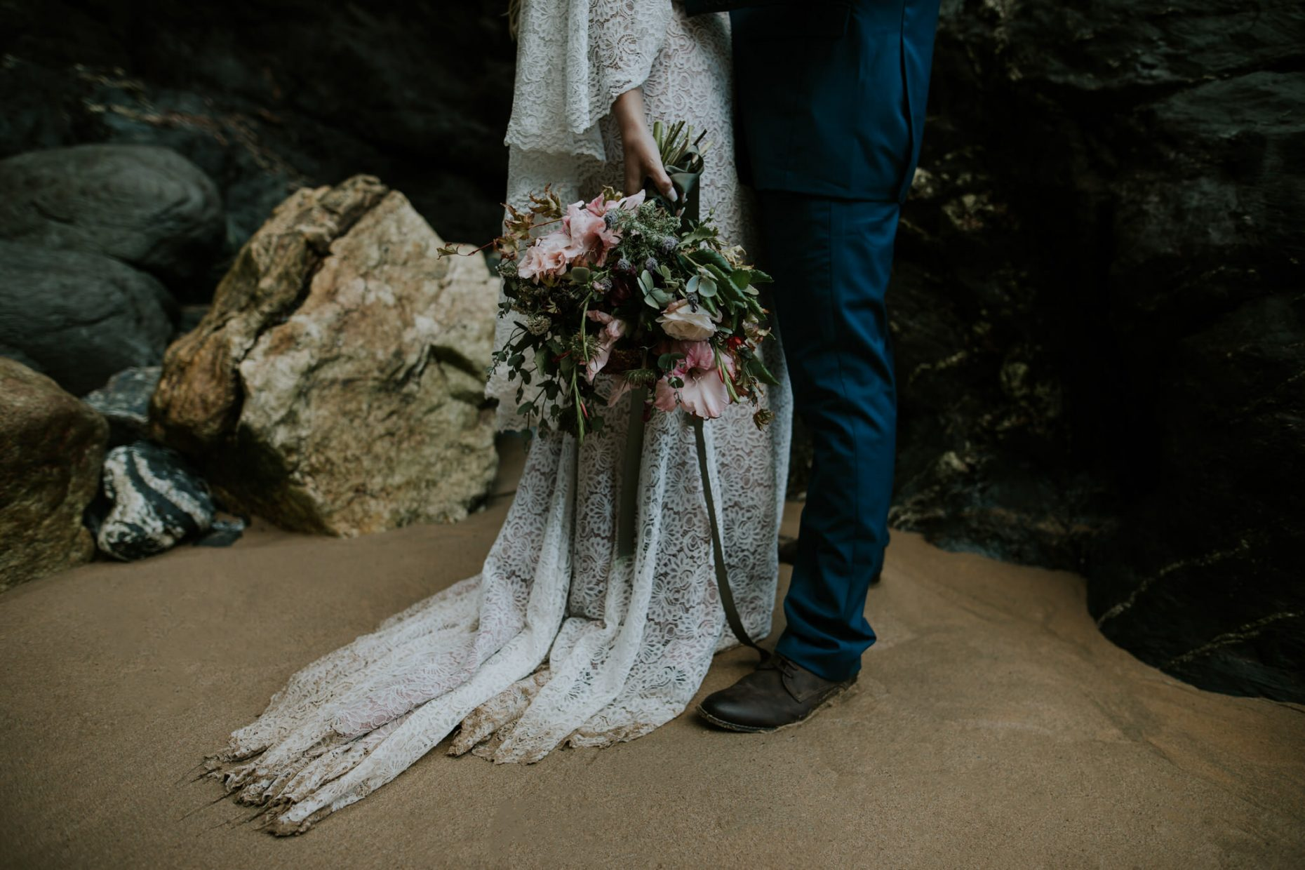 Bride holds her wedding flowers from florist