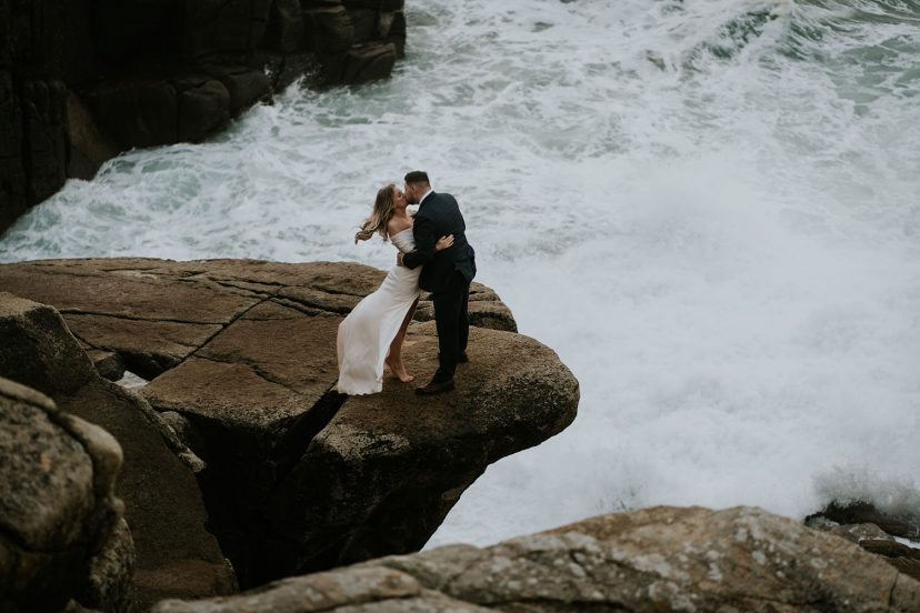 elopement couple kiss on a cliff
