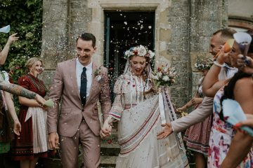 Happy Wedding Couple with Guest around walk hand in hand in castle