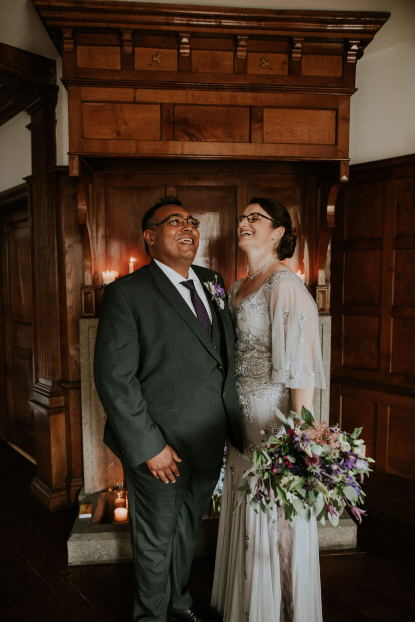 bride and groom laugh together during their elopement ceremony