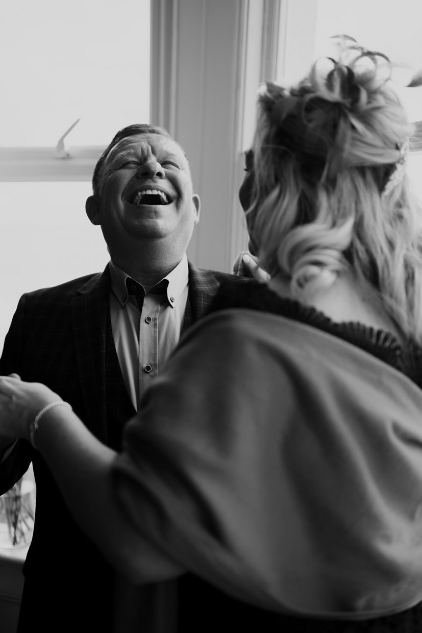 Couple laughing during their intimate romantic ceremony at a small intimate wedding venue in Cornwall