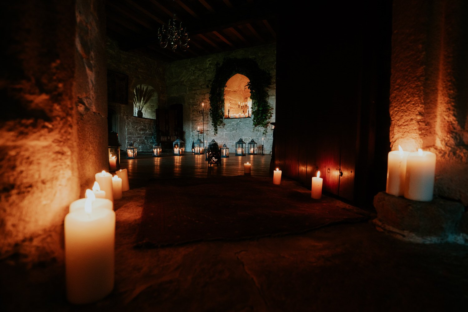 Small Wedding Venues - Candelit Roomwith golden light in a Cornish wedding castle