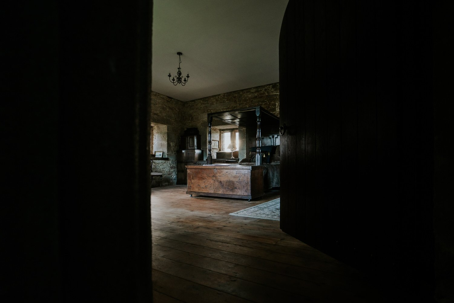 Bedroom at pengersick castle in cornwall with wooden bed