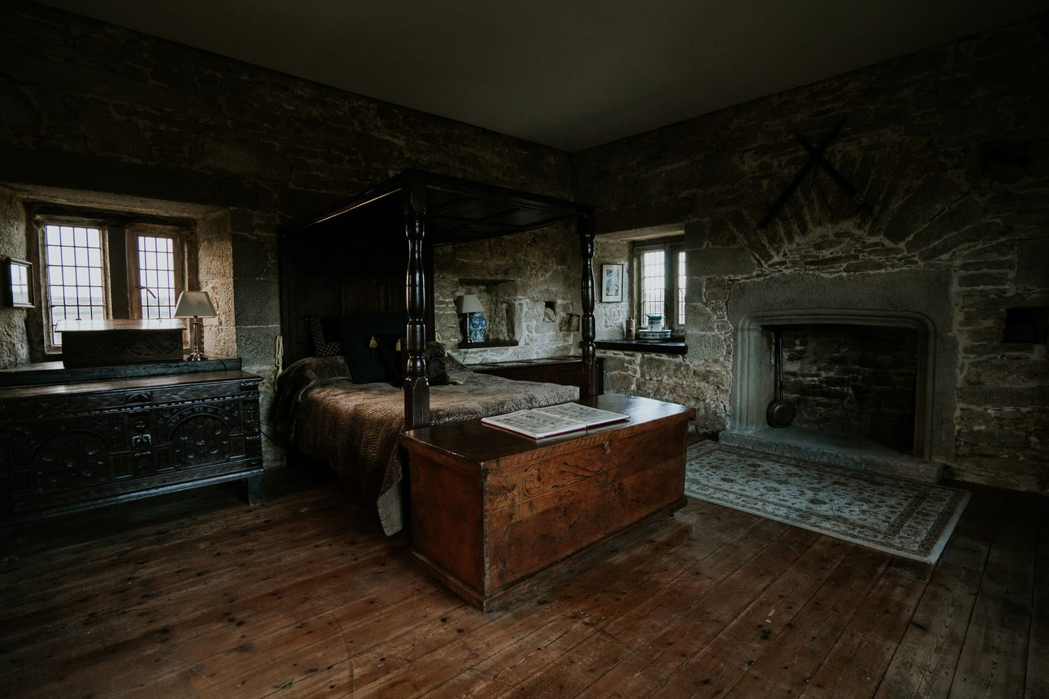 Bedroom with Fireplace and old Bed in Cornwall Pengersick Castle