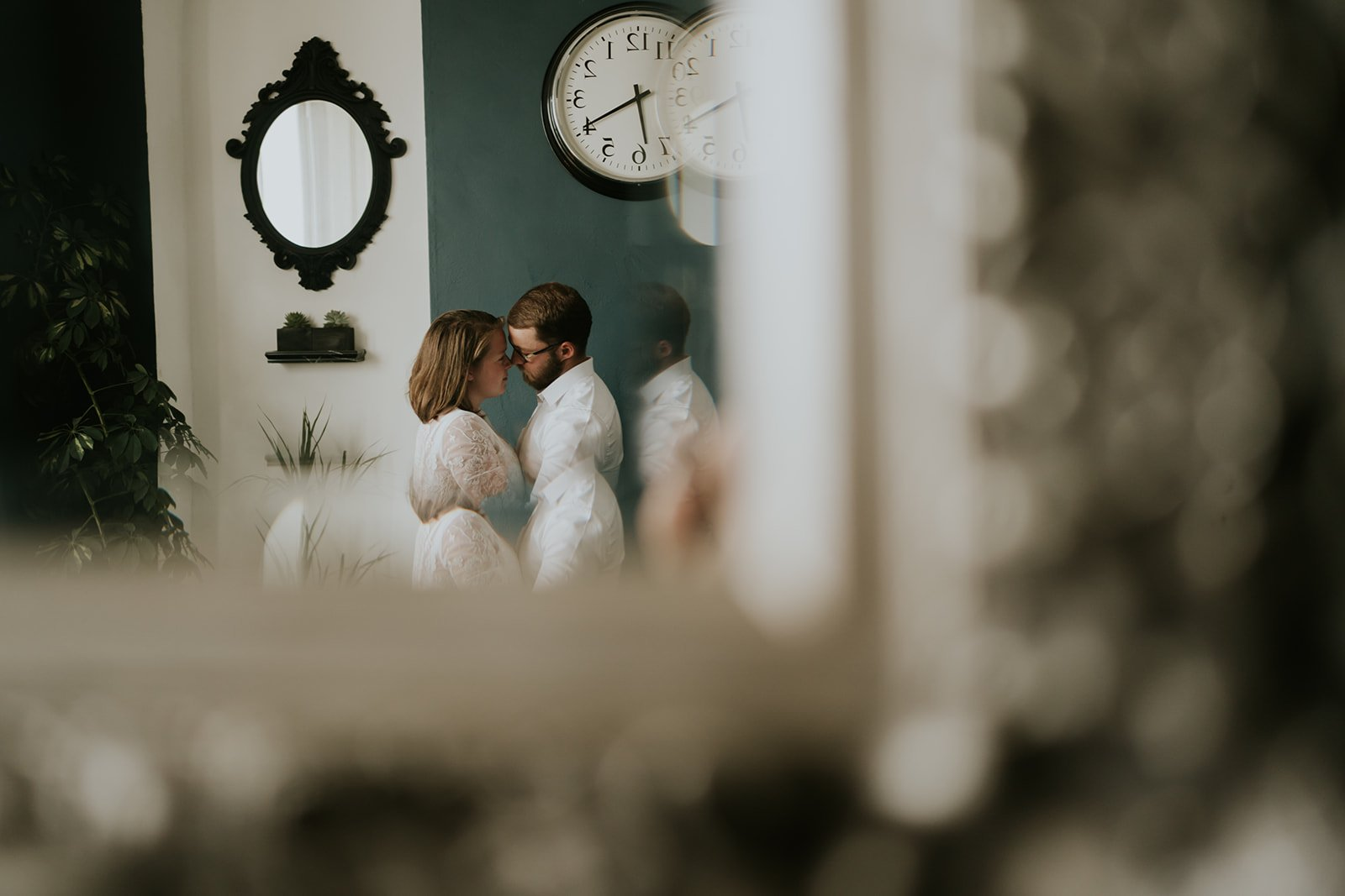 A reflection of a couple kissing in a mirror