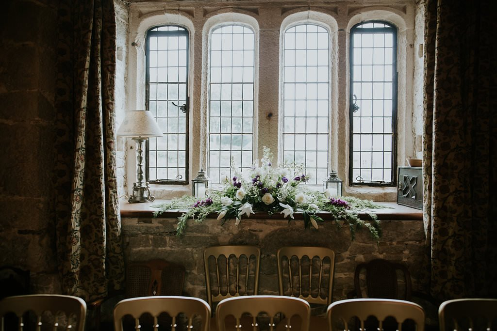 Old Window with wedding Flowers & Chairs in a Wedding Castle Venue