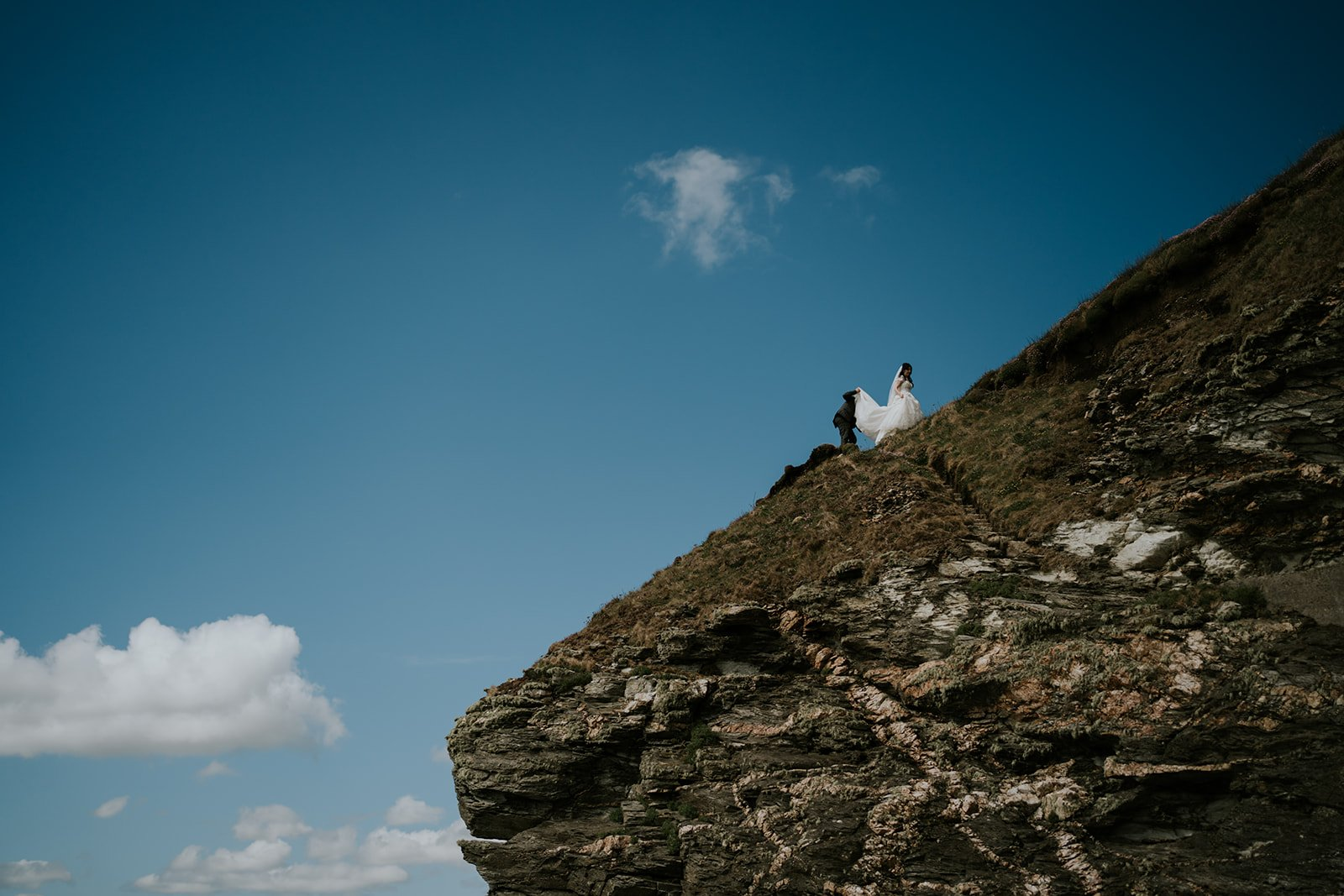 Wedding Couple walk on Cliffs on their Cornwall Elopement