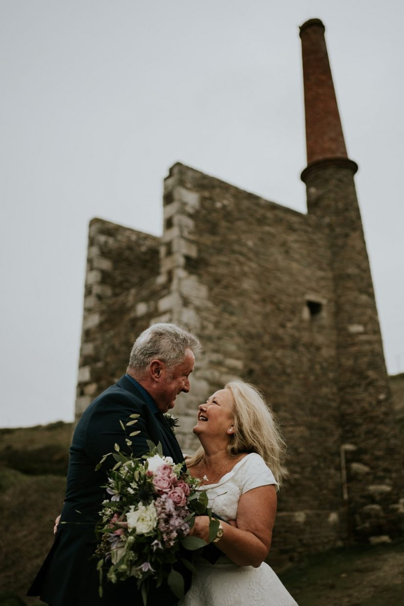 Elopement Couple on their Cornwall Elopement happy at the mines in Rinsey