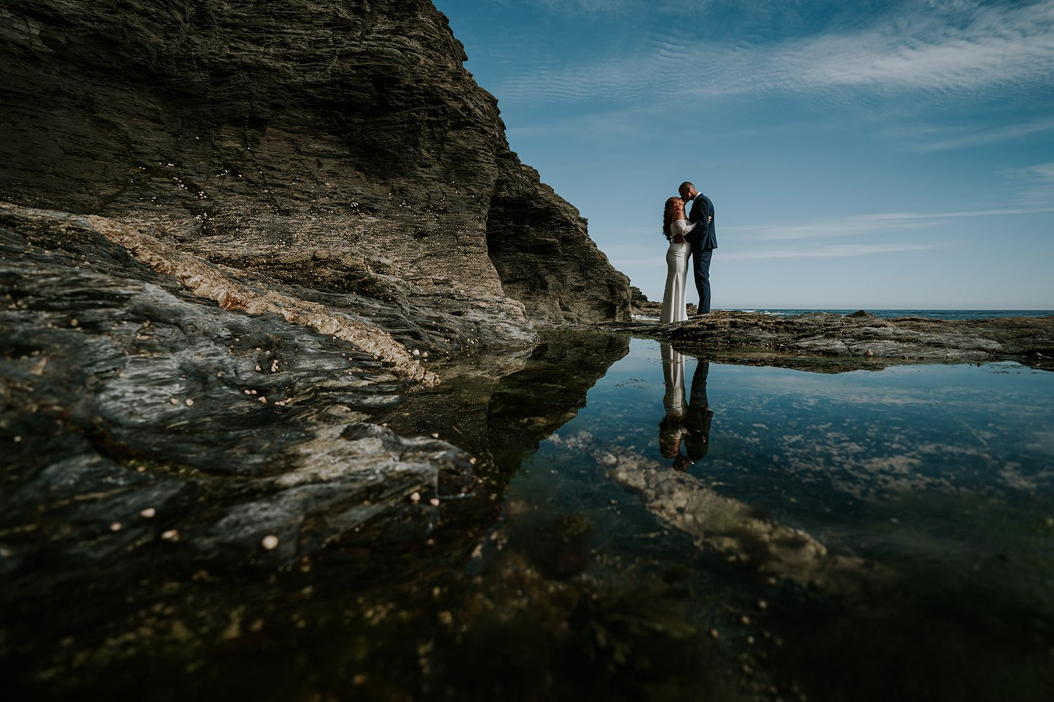 Wedding Couple in Porthleven kiss on a Beach