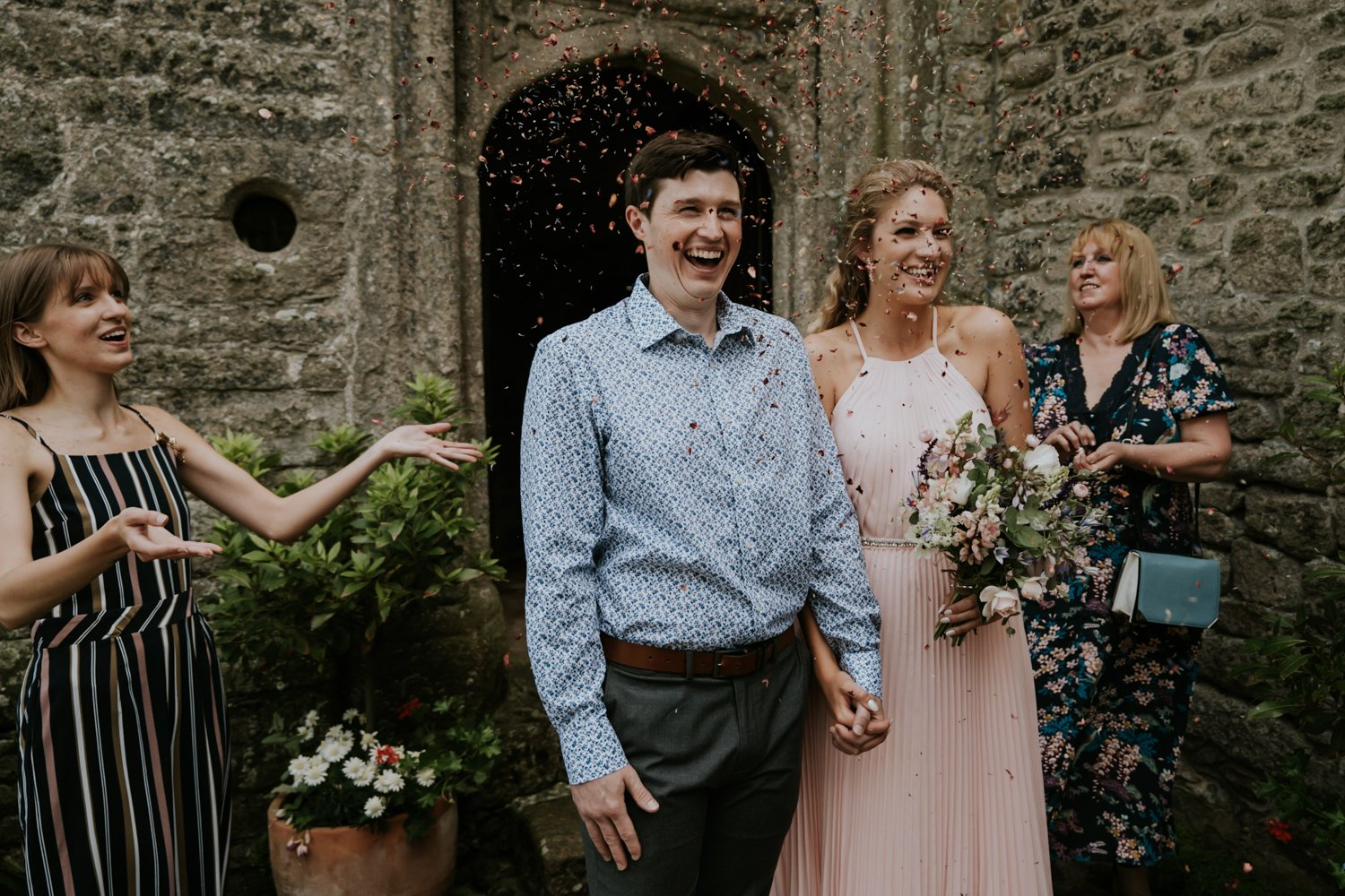 Confetti after Wedding with happy wedding Couple in Cornwall