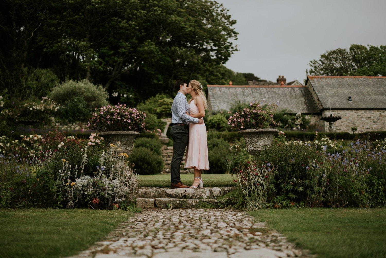 Wedding Couple kiss in the Garden on Pengersick Castle
