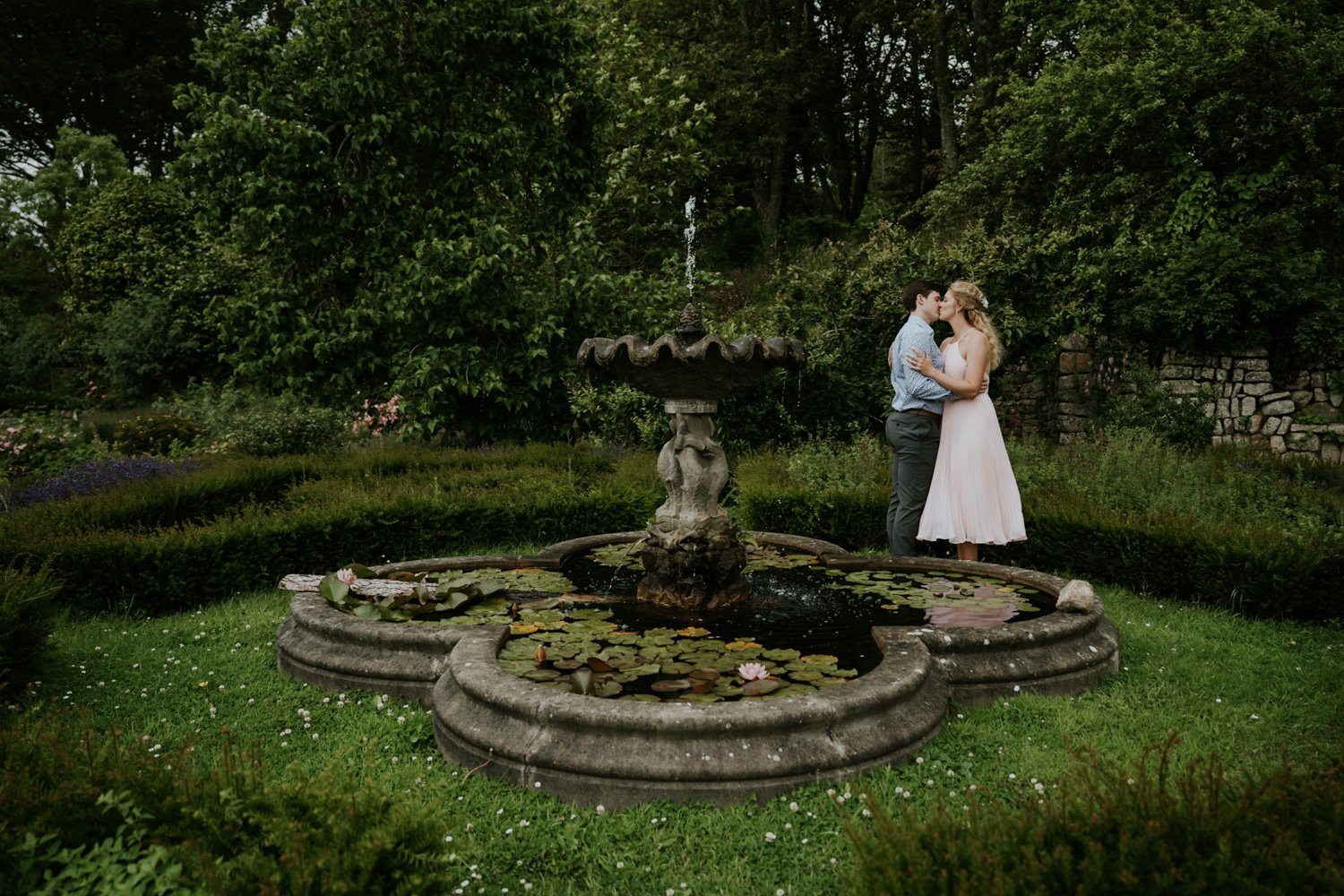 Old English Garden with Elopement Couple kissing intimate in Garden