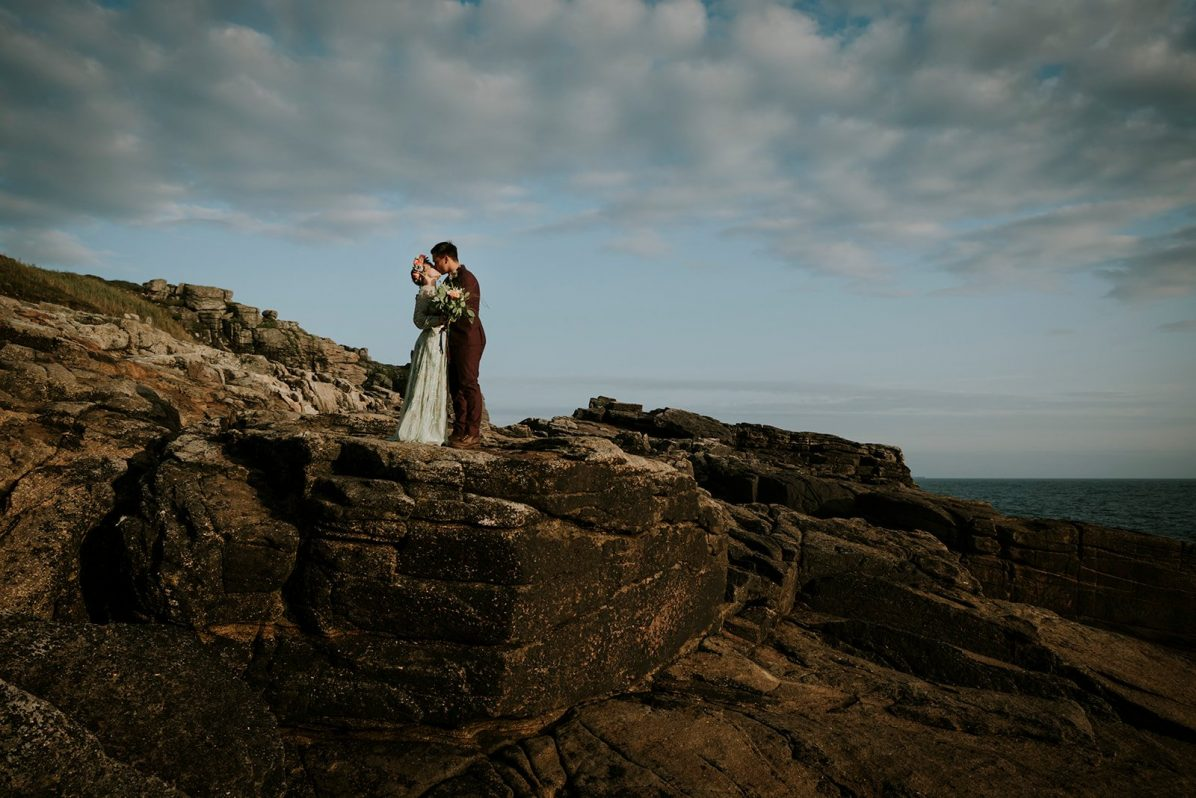 Kissing wedding couple on their elopement
