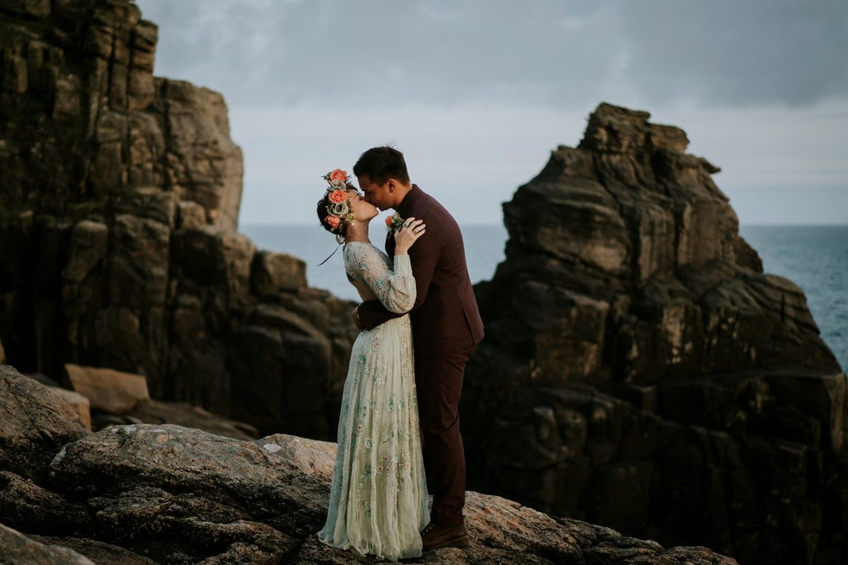 outdoor elopement with kissing couple on the cliffs